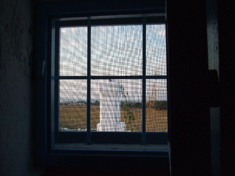 Masseria - Ostuni - vacanze - alloggio 2 - finestrino cucina